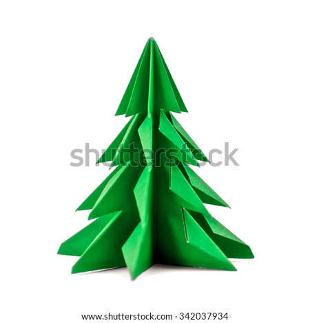 Origami Christmas tree paper isolated on white background. For decoration, Merry Christmas postcard vintage with green paper. Happy New Year. Front view. Close up. - stock photo