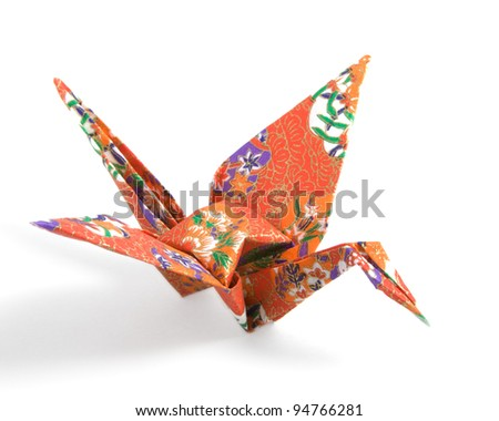 Origami Crane folded with a red floral pattern paper