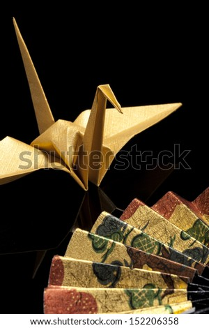 origami crane on black background - stock photo