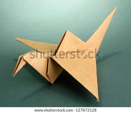 Origami crane on grey background - stock photo