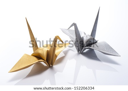 origami crane on white background - stock photo