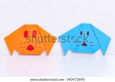 Origami dog from paper color on white background. - stock photo