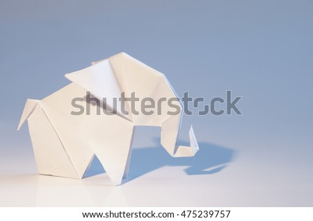 Origami elephant out of paper isolated on white background