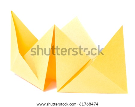 origami figure of yellow ship (isolated on white)