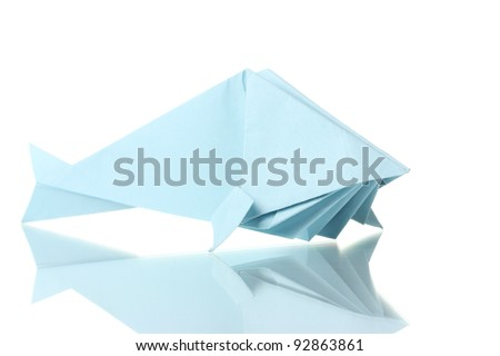 Origami fish out of the blue paper isolated on white - stock photo