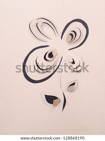Origami flower on the grey background. - stock photo