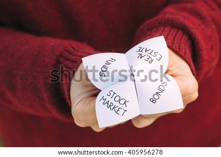 Origami fortune teller with investment choices. Ideal image for financial consultancy themes. - stock photo