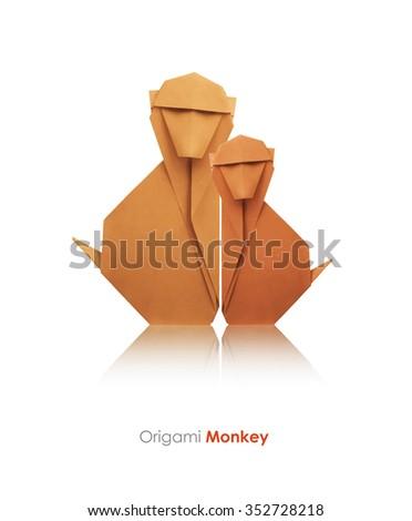 Origami geometri? paper monkey family on a black background - stock photo