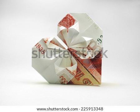 origami heart of five thousand ruble note - stock photo