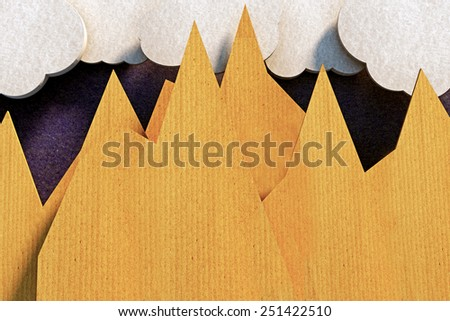 origami mountains made with cardboard paper - stock photo