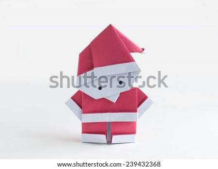 Origami paper craft Santa Claus on white background - stock photo