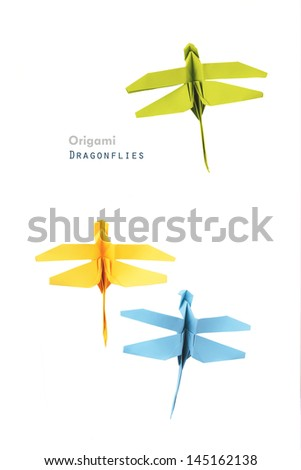Origami paper dragonflies on a white background - stock photo
