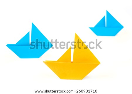 Origami paper ships on leading - stock photo