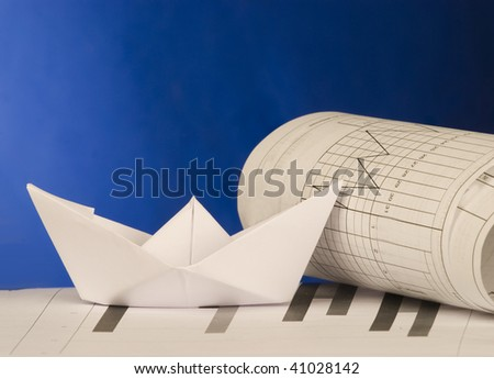 Origami ship with graphics - stock photo