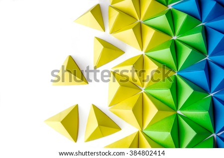 Origami tetrahedrons background. Futuristic polygonal composition with copy space on the left side. - stock photo