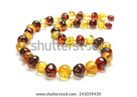 Original amber necklace isolated on the white background - stock photo