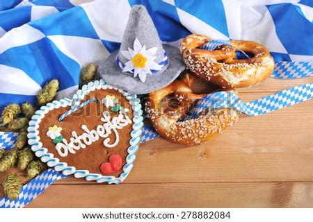 original bavarian gingerbread heart with Oktoberfesthat and soft pretzels - stock photo