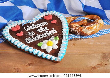 original bavarian Oktoberfest gingerbread heart flag and soft pretzel from Germany - stock photo