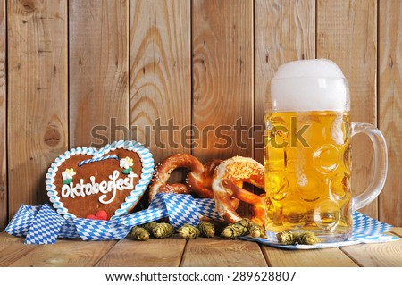 original bavarian Oktoberfest gingerbread heart with beer mug and soft pretzels from Germany