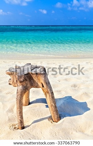 Original  beach table is made from trunk of tree, Maldives, The Indian Ocean - stock photo