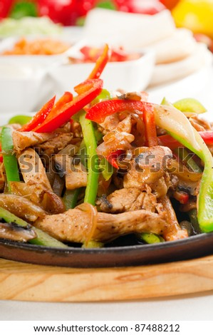 original fajita sizzling smoking hot served on iron plate and fresh vegetables on background ,MORE DELICIOUS FOOD ON PORTFOLIO