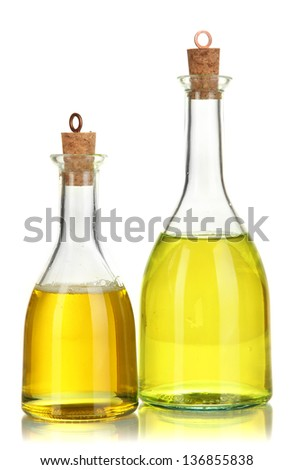 Original glass bottles with salad dressing isolated on white - stock photo
