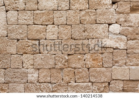 Original medieval limestone facade in Ippoton (Street of the Knights) in Rhodes Old Town (a Unesco World Heritage Site) in the Dodecanese island of Rhodes, Greece. - stock photo