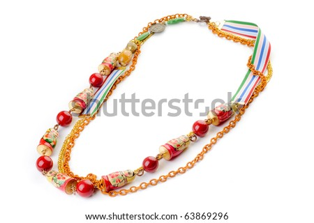 Original necklace with matrioshka, red beads and ribbon