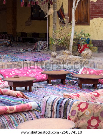 Original objects and living for interior of traditional Bedouin homes in the Arabian desert. Visiting Bedouin in Egypt - African adventure in muslim cultural tradition. - stock photo