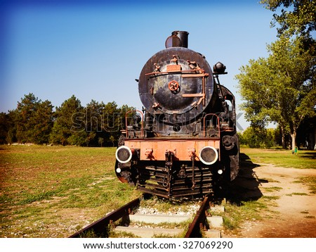 Original passengers steam-power train from the Orient Express era at the old railway station - stock photo