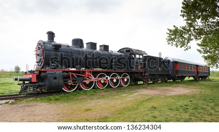Original passengers steam-power train from the Orient Express era at the old railway station in Edirne, Turkey. - stock photo