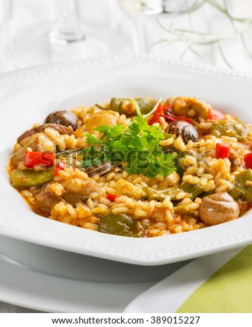Original rice paella from Valencia with chicken and snails