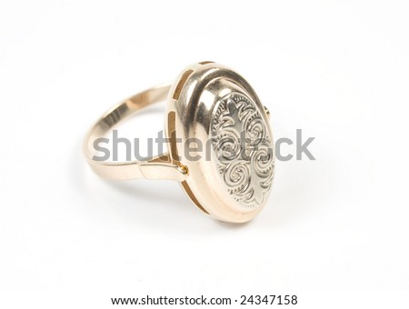 Original ring from gold with ornament on white