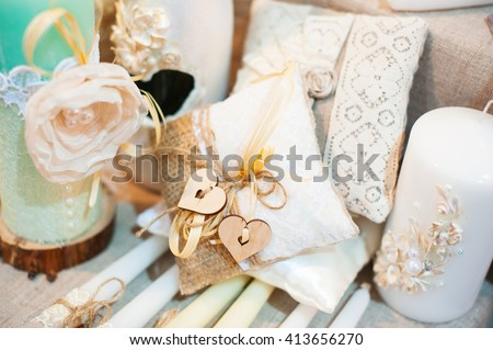 Original wedding decoration in form mini-vases and bouquets of flowers on ceremony