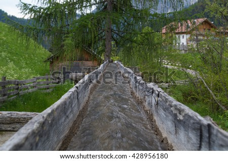 Original wooden irrigation water channel of a mill in italy