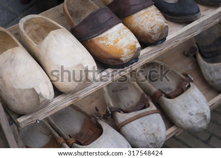Original wooden shoes on a wooden shelf - stock photo