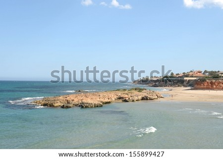 ORIHUELA COSTA, SPAIN - MAY 29:  Orihuela Costa is recognized as the cleanest ecological region of Europe. Beach  in May 29, 2013 in Orihuela Costa, province of Alicante, Spain.