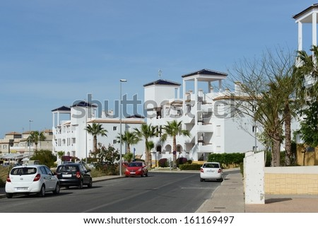 ORIHUELA COSTA, SPAIN - MAY 8:  Orihuela Costa is recognized as the cleanest ecological region of Europe.  Residential complex in May 8, 2012 in Orihuela Costa, province of Alicante, Spain.