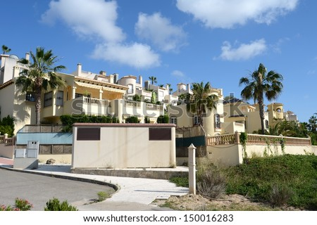 ORIHUELA COSTA, SPAIN - MAY 26:  Residential complex in May 26, 2013 in Orihuela Costa, province of Alicante, Spain.  Orihuela Costa is recognized as the cleanest ecological region of Europe.