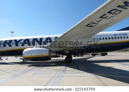 ORIO AL SERIO, BERGAMO, ITALY - CIRCA SEPTEMBER 2015: Ryanair aircraft Boeing 737-800 parked at the airport, detail view of the left wing