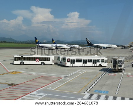 ORIO AL SERIO, ITALY - CIRCA SEPTEMBER 2014: Ryanair Jet airplanes and passenger shuttles at the airport