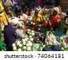 ORISSA,  INDIA - NOV 12  - Indian villagers sell eggplant  and other vegetables on Nov 12, 2009 in Orissa, India - stock photo