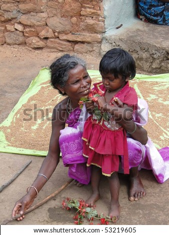 ORISSA,  INDIA - Nov 13 - Tribal woman and her young child on Nov 13, 2009, in Orissa, India - stock photo