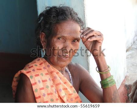 ORISSA,  INDIA - NOV 10  - Tribal women pose for portraits on their porches on  Nov 10, 2009 in Orissa, India. - stock photo