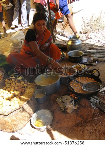 ORISSA INDIA - NOV 10  - Woman prepares fried food for snacks at a  weekly market on Nov 10, 2009 in Orissa, India