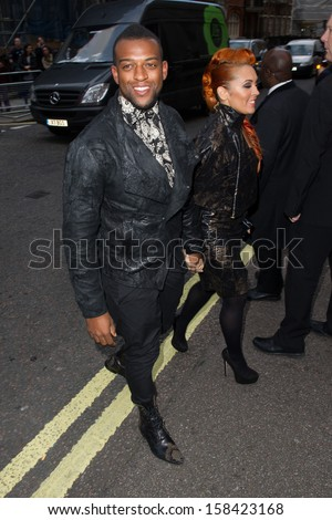 Oritse Williams and AJ Azari arriving for the 2013 Pride of Britain Awards, at the Grosvenor House Hotel, London. 07/10/2013