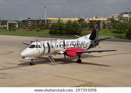 ORLANDO - APRIL 26: Silver Airways regional turboprop airplane prepares for flight from Orlando Florida on April 26, 2015. SIlver connects destinations throighout Florida - stock photo
