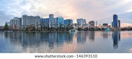 Orlando downtown Lake Eola panorama with urban buildings and reflection - stock photo