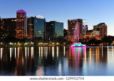 Orlando downtown skyline panorama over Lake Eola at dusk with urban skyscrapers and clear sky. - stock photo