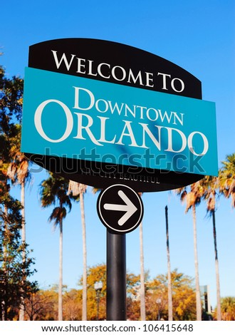 Orlando downtown welcome sign with tropical scene - stock photo